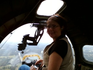 Cindy Bryan sitting in the Bombardier Position
