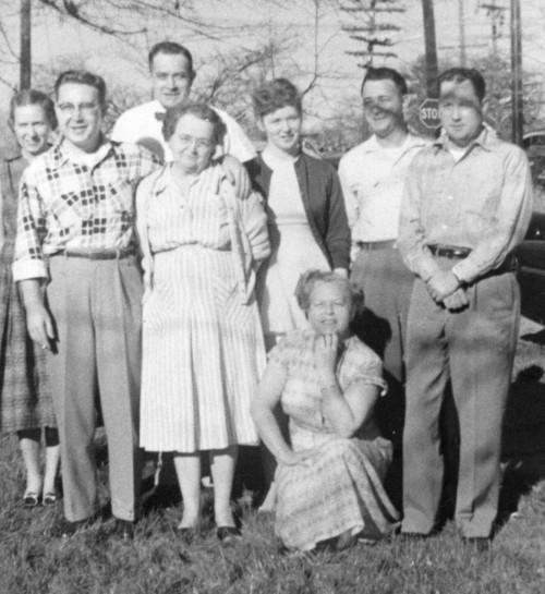 Standing L to R: Janet, Gene, Carroll Jr, Raleigh Mae, Beverly, Bob, and Ed Kneeling: Gerry