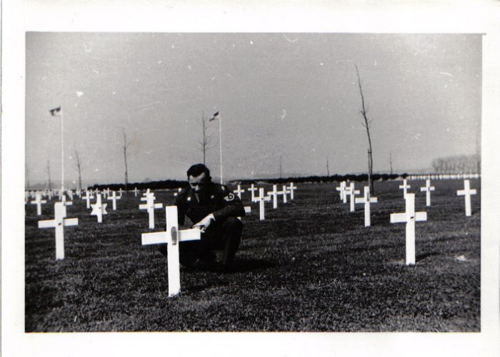 NEEDS ID PHOTO 007. The location the grave of Lenard Leroy Bryant at Margraten Cemetery in the Netherlands. I need the ID of the man kneeling.