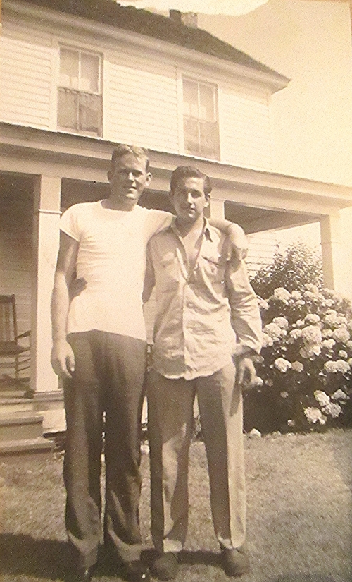 Friends and schoolmates, left to right, Dink Bishop and Harry Liniger Standing in front of Harry's mother's house in Gatesville, NC