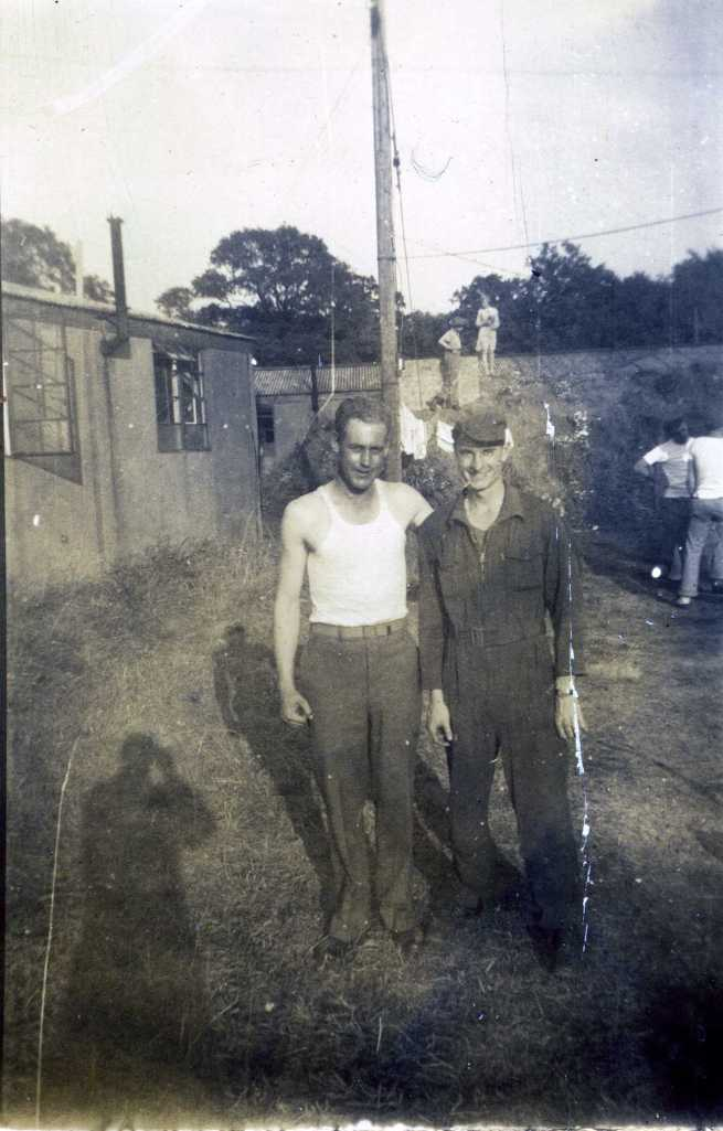 NEEDS ID Photo 001:  I believe the man on the left Lenard Leroy Bryant of the John Oliver Buslee crew, 384th Bombardment Group, 544th Squadron.  Need ID on other individuals and location.