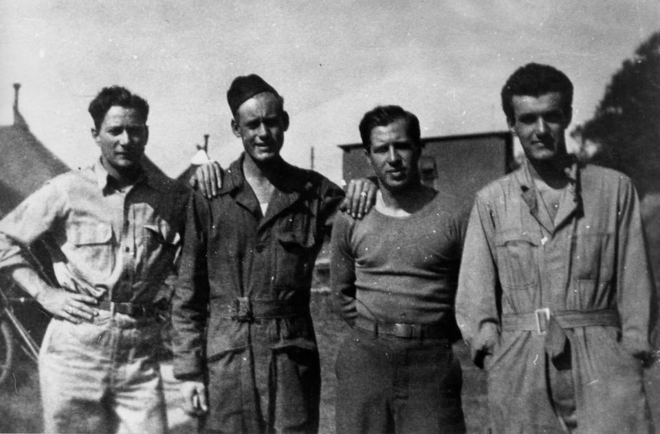 Four of the John Buslee Crew, left to right, George Edwin Farrar (waist gunner), Lenard Leroy Bryant (engineer/top turret gunner), Erwin V. Foster (ball turret gunner), and Sebastiano Joseph Peluso (radio operator/gunner)