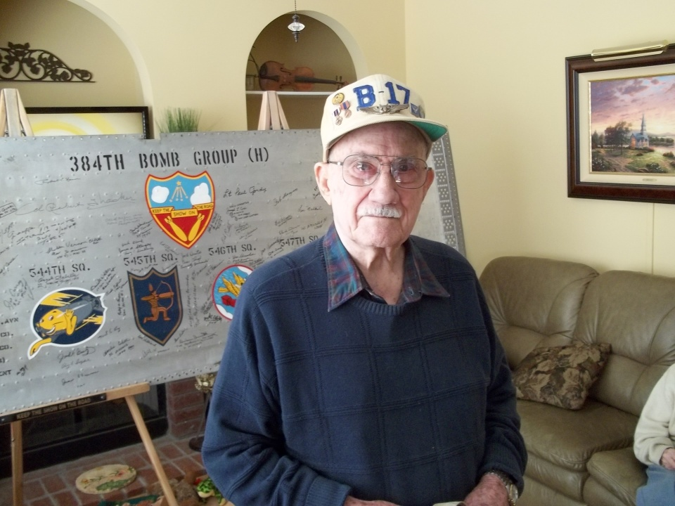 Robert McKinley Mitchell Signs the 384th Bomb Group Wing Panel January 2014