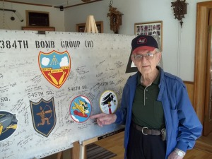 "Arthur ""Ozzie"" Osepchook signs the 384th Bomb Group's Wing Panel"