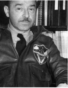 "Col. Budd J. Peaslee wearing 384th Bomb Group motto patch. The patch reads ""Veni Vidi Vici"", meaning ""I came, I saw, I conquered."""