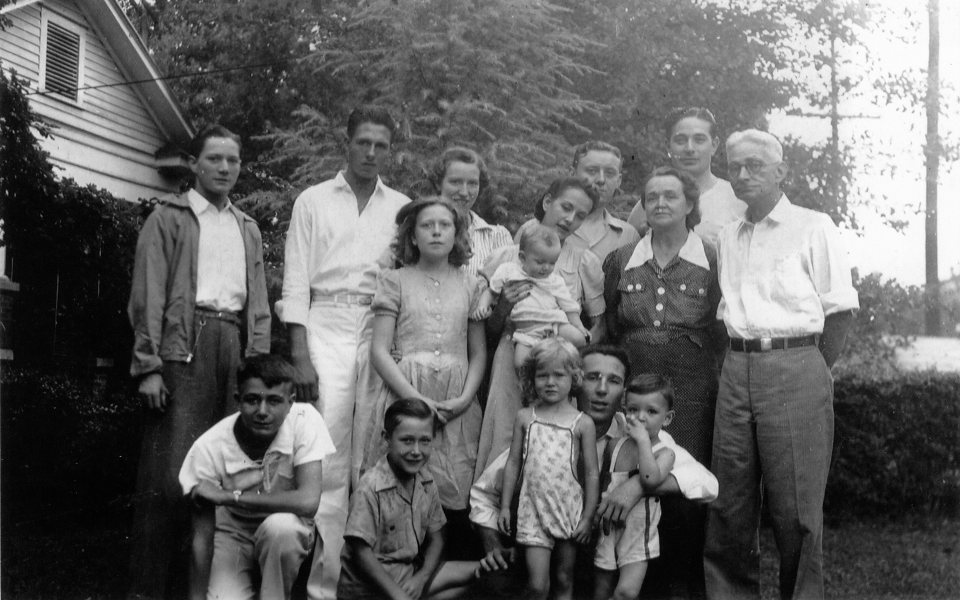 Standing back row, L to R: Ed, Bob Hunt, Janet, Unknown, Carroll, Jr. Standing middle row, L to R: Martha, Dot holding Phyllis, Raleigh, and Carroll, Sr. Kneeling, L to R: Bob, Gene, Beverly, Hugh Cobb, and Denney