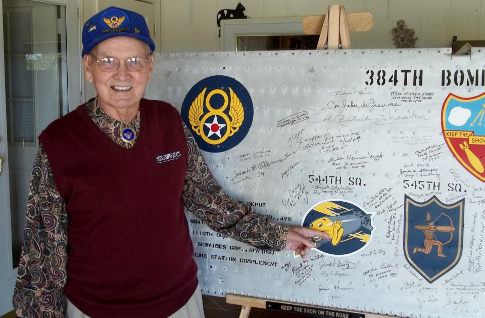 Eugene Spearman signs the wing panel in October 2014