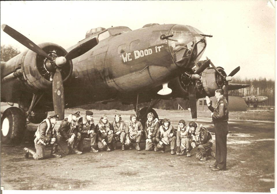 Father Billy blessing crew before mission take-off. This photo was published nationally. The crew was shot down on January 30, 1944. Seven of the crew were killed and three taken prisoner.