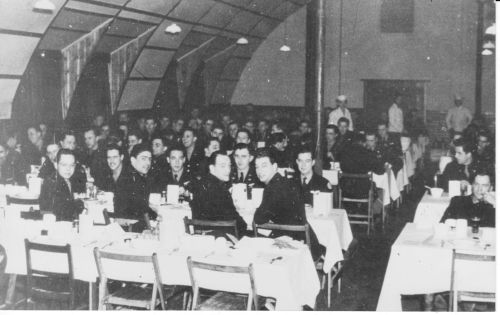 384th BG Officers' Mess, photo part of the Leroy Arquette Collection.  Leroy is by the pole towards the back.