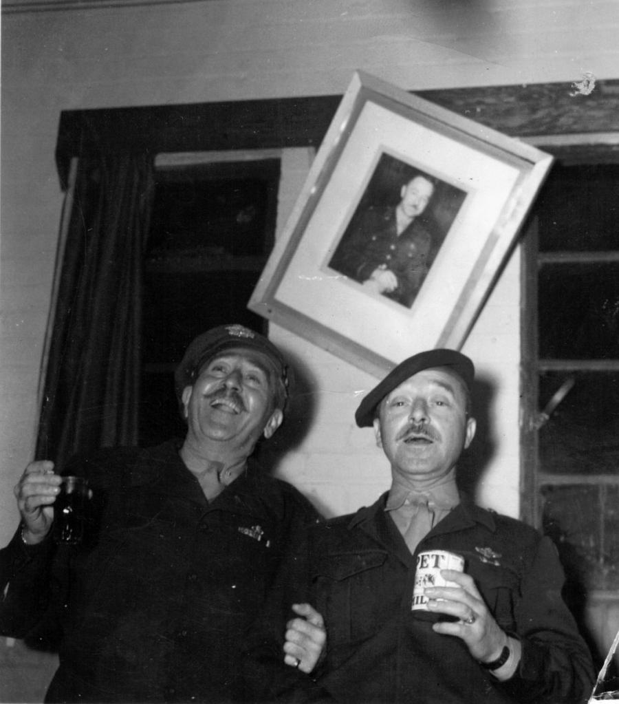 American actor Adolphe Menjou on the left and the first commander of the 384th Bomb Group, Colonel Bud Peaslee on the right at the Officers' Club.