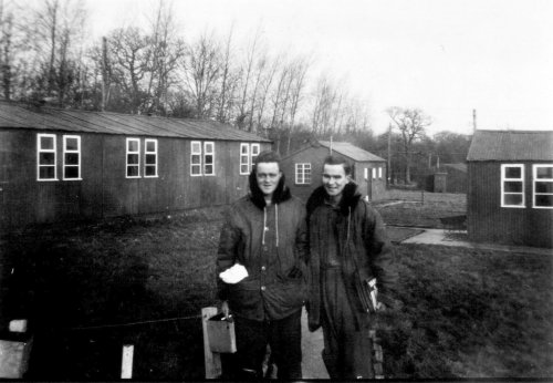 "Left to right: Robert Alderman and Forrest ""Skip"" Fickling in front of the barracks"