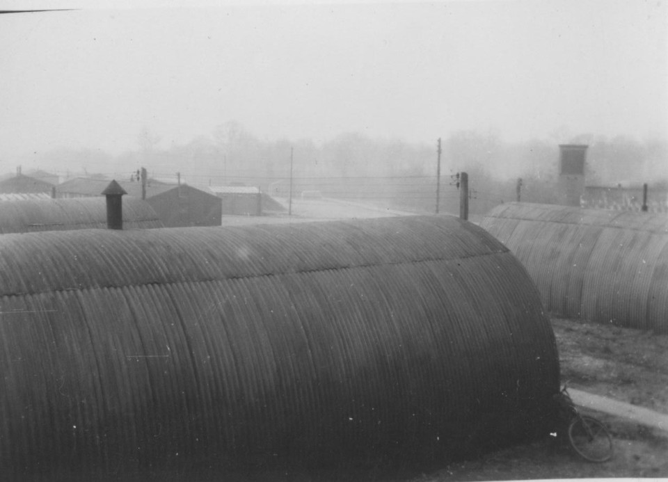 Nissen huts in the foreground and other barracks in the background