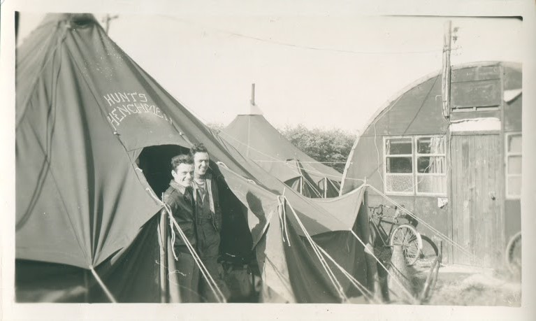 Cliff Linn and J.P. Vargas of the John Hunt crew in front of their tent.