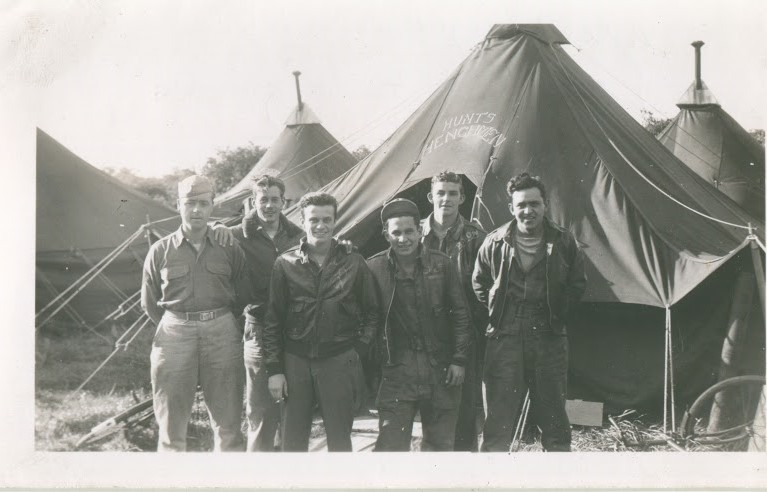 Enlisted men of the John Hunt crew in front of their tent.