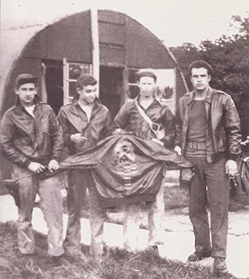 Harry Liniger on the left, Robert Crumpton third from left. Other members of the Brodie crew. Nissen hut in the background.