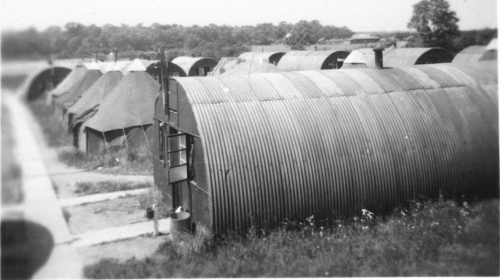 Foreground - Nissen huts. Background - tents.