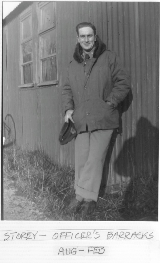 Wallace Storey standing in front of his barracks.