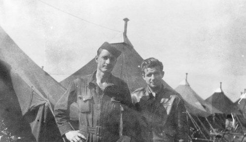 On the left is either Carl Guinn or Thomas Everitt. On the right may be Richard Rafeld or one of the Norton crew. Tents likely in the 544th Bomb Squad area of Grafton Underwood.