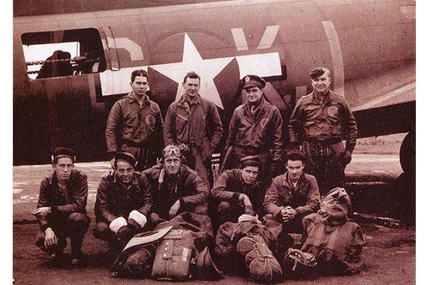 Harris, Algar 42-30026 BATTLEWAGON - 30 July 1943 Kassel (A/C Industry) – Not in Photo: Lt. S. Taylor (OBS/TG) OR 14 October 1943 Schweinfurt (Ball-bearings) – Not In Photo: Lt. R. Wolf (OBS/TG) Back L-R: Capt. George Harris (AC/CP), 1st Lt. James McClanahan (B), 1st Lt. Frank Celentano, 1st Lt. Philip Algar (P) Front L-R: Sgt. Francis Gerow (RO), Sgt. John Schimenek (FG), Sgt. Casmer Majewski (FG), Sgt. Kenneth McKay (BT), Sgt. Roland Laviolette (TT) Aircraft: B-17F 546th BS 42-30026 BK*J Battlewagon; Roland Flynn crew chief