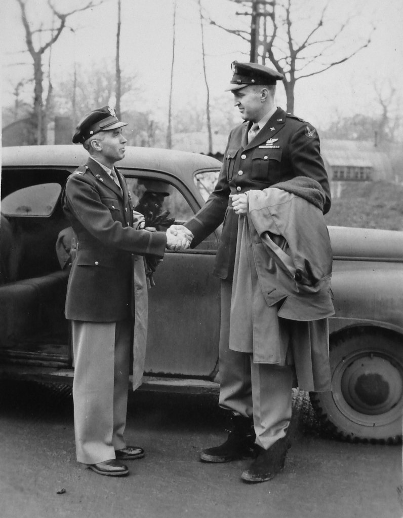 Col. Julius Lacey (on left) hands off command of the 384th Bomb Group on November 23, 1943 to Col. Dale O. Smith (on right)