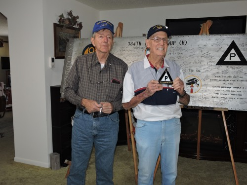 L to R: Keith Ellefson presents Fred Rubin with a 384th bomb group hat, a triangle P pin, and a handmade (by Keith) stained glass triangle P memento.