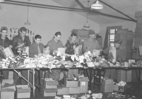 Packing Christmas gifts for Nantes, France, Bethlehem Orphanage in 1944. Might be LT Oscar Picard on far right. Source: Robert Bletscher Collection