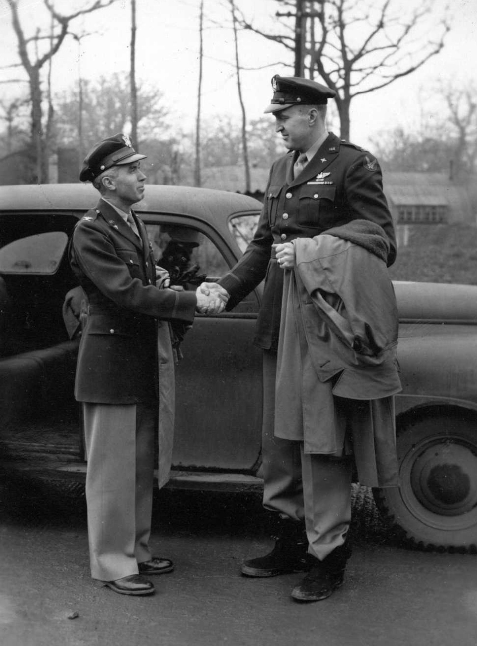 Col. Lacey hands off command of the 384th Bomb Group to Col. Dale Smith on November 23, 1943