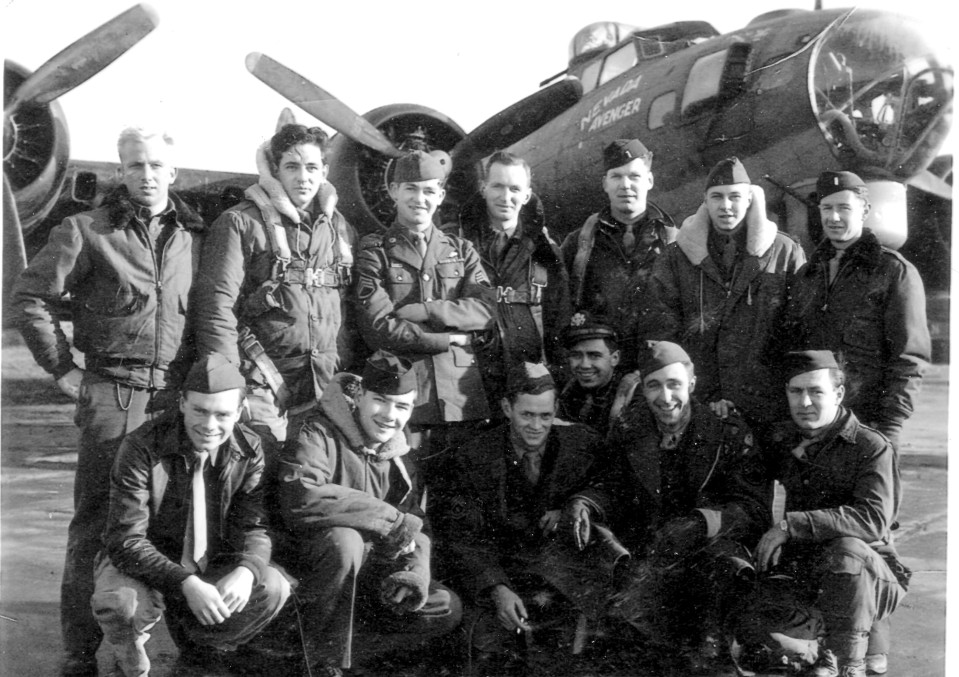The flight to Nantes, France to deliver Christmas gifts to the children on 30 December 1944. Back row (left to right): Unidentified news reporter or observer; Unidentified; S/Sgt. Albert S. Horan (Ball Turret); Unidentified; Lt. Robert C. Owens (Pilot); S/Sgt. William D. Munro (Radio Operator/Gunner); Lt. William Barry (Navigator); Front row (left to right): Unidentified; S/Sgt. Carlton W. King (Tail Gunner); S/Sgt. Vanny D. Squires (Top Turret/Engineer); Lt. Richard C. Buswell (Co-pilot); S/Sgt. Vernon P. Gardner (Waist Gunner); S/Sgt. Ivan C. Berry (Waist Gunner). Missing from this photo is Lt. Lambert Muller-Thym (Bombardier). The unidentified men were probably along for the Christmas celebration.