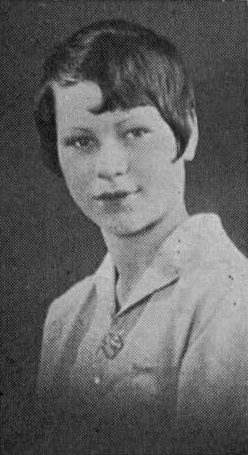 Page Browne Lacey, wife of Julius K. Lacey, in a school yearbook photo. Caption reads: A small person that radiates pep and joyousness.