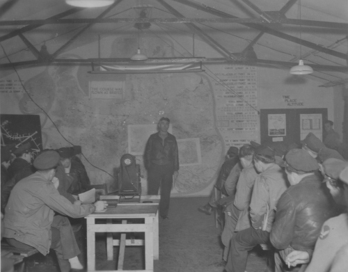 Col. Julius K. Lacey at a mission briefing, Grafton Underwood