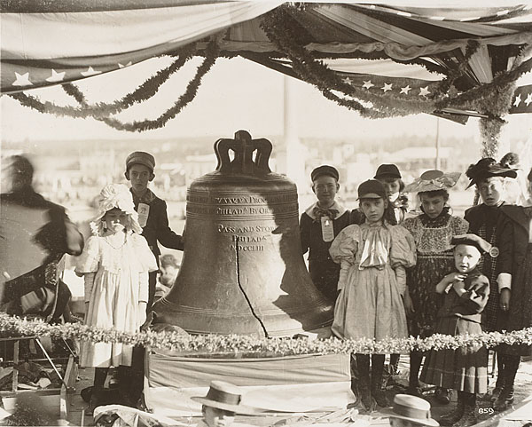 Children surround Liberty Bell at Cotton States Exposition in Atlanta, Georgia