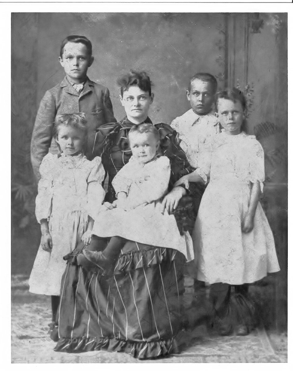 "The George family after Raleigh David's death. Pictured are (and this is my guess based on ages): Standing back L: James England George Standing back R: Hayden Edger George Standing front L: Julia Cleo George Standing front R: Eunice ""Ennis"" George Seated: Mary Willie Hollingsworth George, holding Raleigh May George"